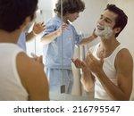 boy applying shaving foam on...   Shutterstock . vector #216795547