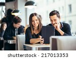 young couple looking at photos... | Shutterstock . vector #217013353