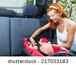 woman baby seats in the car seat | Shutterstock . vector #217033183