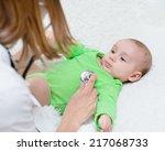 doctor examining newborn baby... | Shutterstock . vector #217068733
