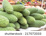 Small photo of Anona fruits on display on a market
