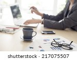 working woman in the office  | Shutterstock . vector #217075507