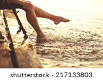 young woman at river on evening ... | Shutterstock . vector #217133803