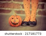 funny child dressed witch... | Shutterstock . vector #217181773