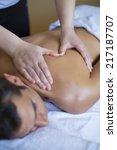 young man having a massage | Shutterstock . vector #217187707