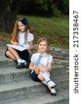 two girls in school uniform ... | Shutterstock . vector #217358467