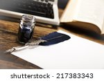 old paper on wooden desk  | Shutterstock . vector #217383343
