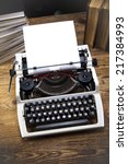 typewriter and a blank sheet of ...   Shutterstock . vector #217384993