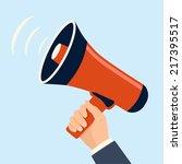 hand holding megaphone... | Shutterstock .eps vector #217395517