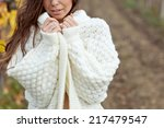 beautiful woman in a sweater in ... | Shutterstock . vector #217479547