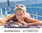 young woman reading a book on a ... | Shutterstock . vector #217540723