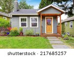 small grey house with wooden... | Shutterstock . vector #217685257