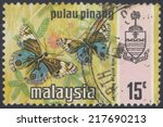 Small photo of MALAYSIA - CIRCA 1976: A stamp printed in Malaysia shows image of a blue pansy (Precis orithya wallacei) butterfly, circa 1976