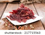 portion of beef jerky on... | Shutterstock . vector #217715563