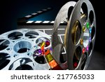 cinema clapper and reels of... | Shutterstock . vector #217765033