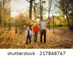 happy family in autumn park... | Shutterstock . vector #217868767