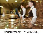 Small photo of Modern luxury hotel reception counter desk with bell