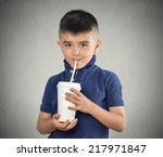child drinking with a straw... | Shutterstock . vector #217971847