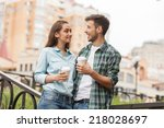 young couple drinking coffee... | Shutterstock . vector #218028697