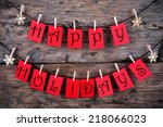 happy holidays greetings on red ... | Shutterstock . vector #218066023