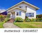 simple house with  blooming... | Shutterstock . vector #218168527