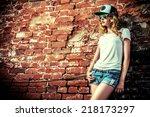 beautiful modern girl near the...   Shutterstock . vector #218173297