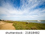 Small fishing boat at Cabanas de Tavira, Portugal. - stock photo