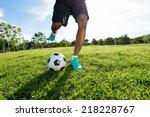 Legs Of Soccer Player Kicking...