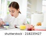 schoolgirl with digital tablet... | Shutterstock . vector #218235427