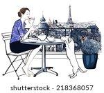 woman having breakfast on a... | Shutterstock .eps vector #218368057
