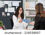 smiling businesswoman passing... | Shutterstock . vector #218538007