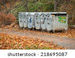 dumpsters by the walking path | Shutterstock . vector #218695087