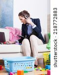 businesswoman doing housework... | Shutterstock . vector #218772883