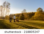 Stock photo couple walk retriever dog autumn sunset countryside meadow holding hands 218805247
