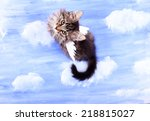 Stock photo beautiful kitten with paper wings on bright background 218815027