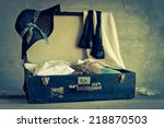 open suitcase with old things... | Shutterstock . vector #218870503