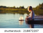 a cute little girl sitting on... | Shutterstock . vector #218872207