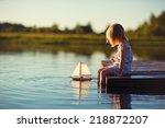 A Cute Little Girl Sitting On...
