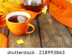 Stock photo cup of tea teapot and tea bags on wooden table close up 218993863