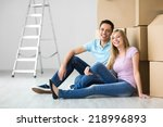 young couple at home with boxes | Shutterstock . vector #218996893