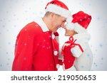 Festive Older Couple Smiling A...
