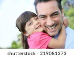 portrait of little girl hugging ... | Shutterstock . vector #219081373