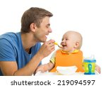 smiling baby eating food | Shutterstock . vector #219094597