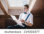 man reading a book during... | Shutterstock . vector #219203377