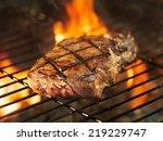 beef steak cooking over flaming ... | Shutterstock . vector #219229747