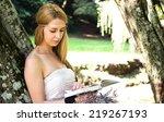 beautiful woman reading a book...   Shutterstock . vector #219267193
