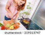 beautiful young housewife in... | Shutterstock . vector #219313747