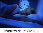 woman awake early in the... | Shutterstock . vector #219428317