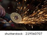worker cutting metal with... | Shutterstock . vector #219560707