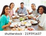 group of friends enjoying meal... | Shutterstock . vector #219591637